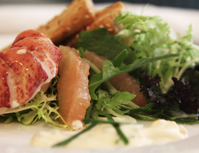 Lobster tail, grapefruit and frisee salad.