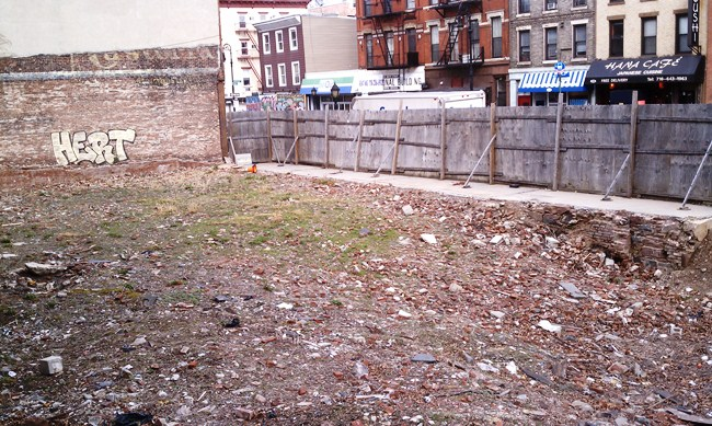 Fencing at 232 Smith is falling apart and illegally placed on the sidewalk.